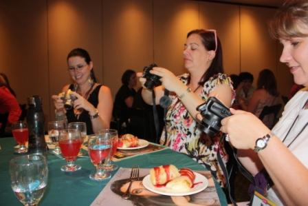 FC final dinner - everyone taking pictures of their dessert