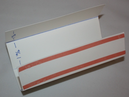 Box top sticky strip placement