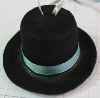 Putting hat band on hat