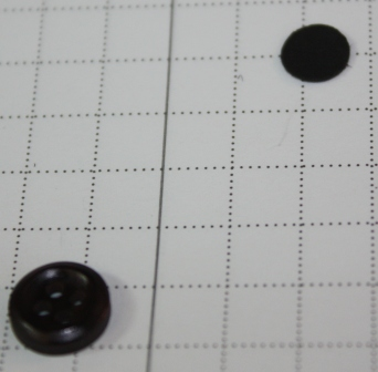 Buttons for eye with punch
